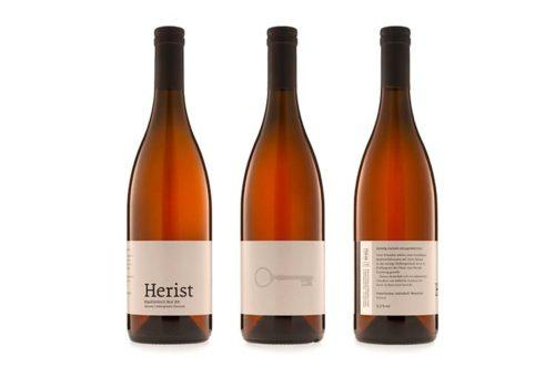 One picture shows wine bottles of Herist wine.